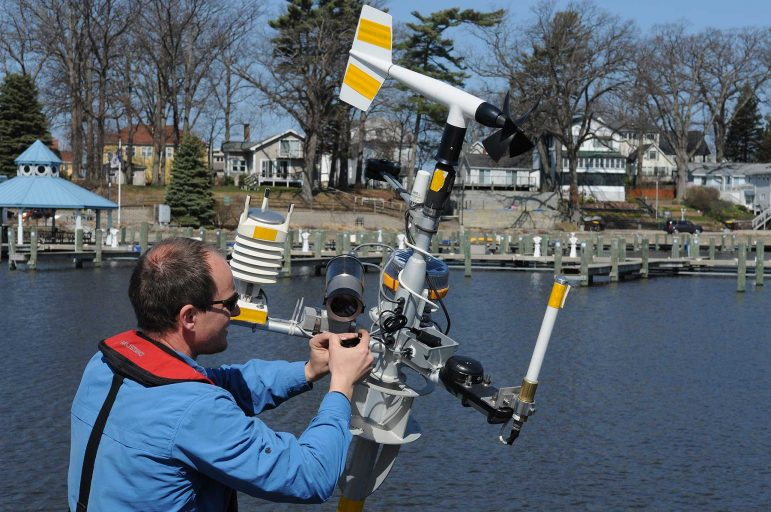 Greg Cutrell of LimnoTech working on buoy deployment in South Haven, Michigan